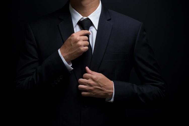 what color shirt goes with black suit